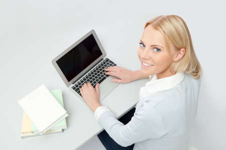 Beautiful student girl studying with laptop Stock Photo - 12475389
