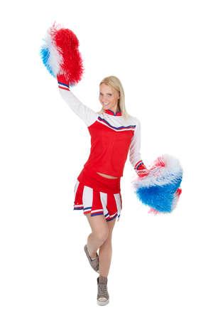 cheerleader: Smiling beautiful cheerleader with pompoms.