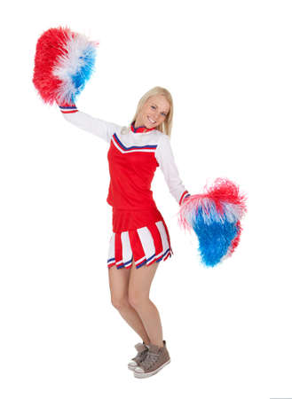 black cheerleader: Smiling beautiful cheerleader with pompoms.
