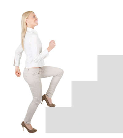 Successful businesswoman walking up a staircase Stock Photo - 12475290
