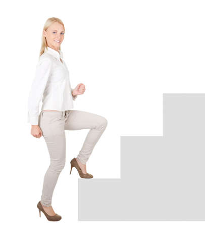Successful businesswoman walking up a staircase Stock Photo - 12475312