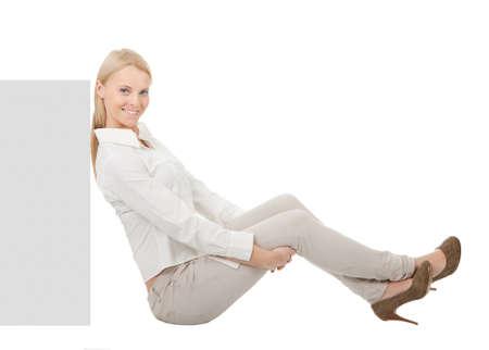 sitting down: Businesswoman sitting next to copyspace