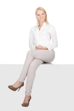 sitting down: Businesswoman sitting on copyspace