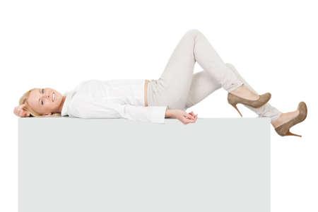 Businesswoman lying on copyspace photo