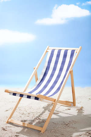 deck chairs: Photo of a deckchair at the sunny beach