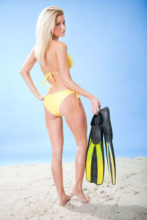 woman diving: Beautiful young woman in bikini with snorkel equipment at the beach Stock Photo