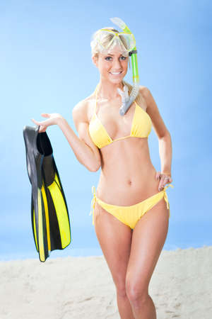 Beautiful young woman in bikini with snorkel equipment at the beach Stock Photo