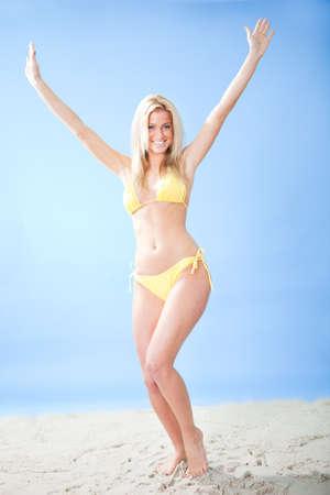 Beautiful young woman in bikini at the beach photo
