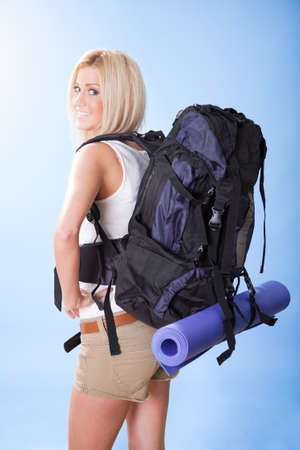 Portrait of beautiful young hiking woman with backpack photo