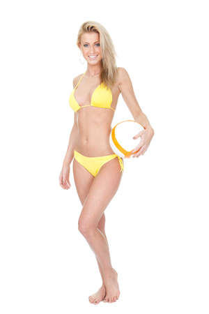 Beautiful young woman in bikini playing football. Isolated on white photo