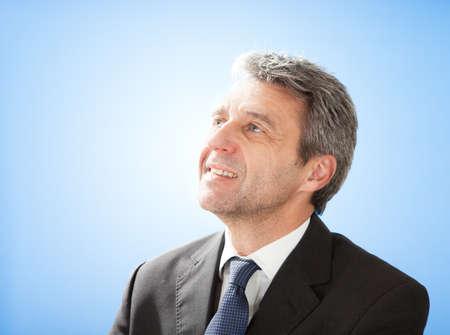 Portrait of successful senior businessman on sky Stock Photo - 12983578