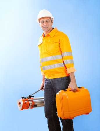 elevation meter: Portrait of Senior land surveyor standing with theodolite equipment