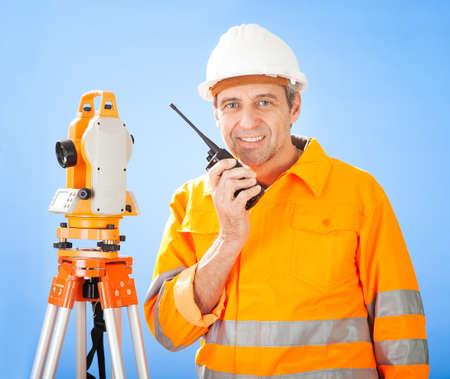 elevation meter: Portrait of Senior land surveyor working with theodolite at construction site