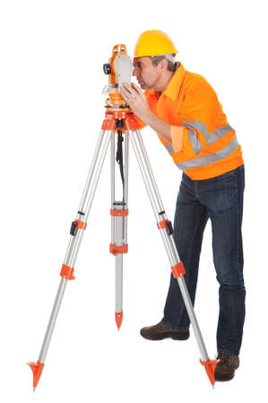 surveyor: Portrait of Senior land surveyor working with theodolite. Isolated on white