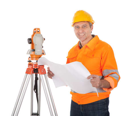 elevation meter: Portrait of Senior land surveyor working with theodolite. Isolated on white
