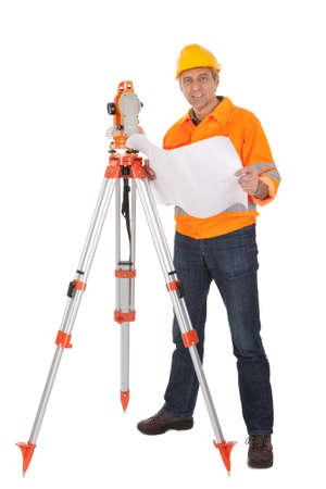 Portrait of Senior land surveyor working with theodolite. Isolated on white photo