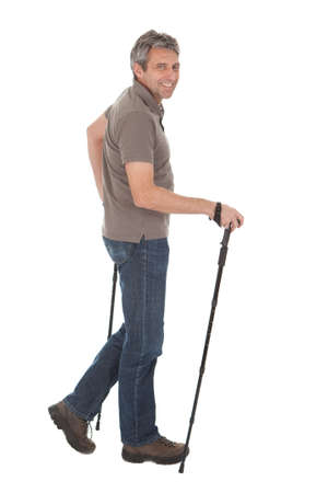 Portrait of senior man with hiking poles. Isolated on white Stock Photo - 12983471