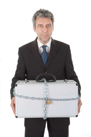 Businessman holding metal suitcase with chain and lock. Isolated on white Stock Photo - 12983527