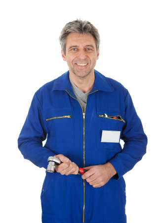 Portrait of automechanic holding a wrench. Isolated on white