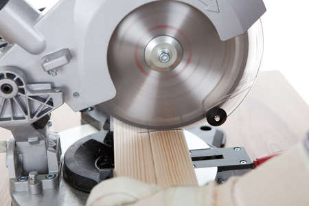 joiner: Worker cutting timber using circular electric saw