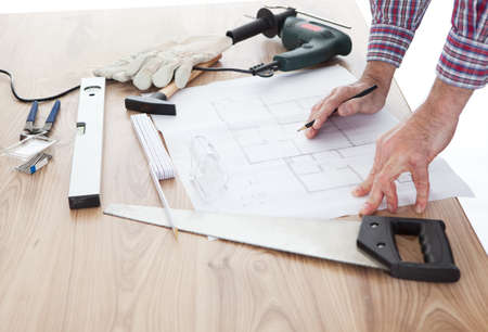 Close-up on worker looking into a house plan photo