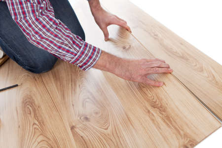 Portrait of worker assembling new laminate floor photo