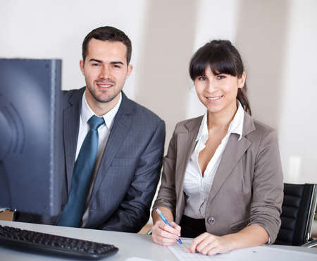 Two confident business people in the office at the meeting Stock Photo - 13020782
