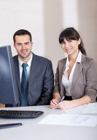 Two confident business people in the office at the meeting Stock Photo - 13020797