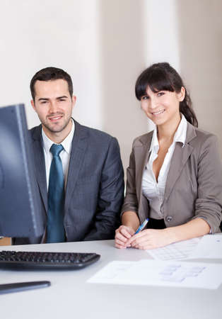 Two confident business people in the office at the meeting Stock Photo - 13020755