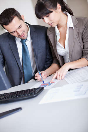Two confident business people in the office at the meeting Stock Photo - 13020535