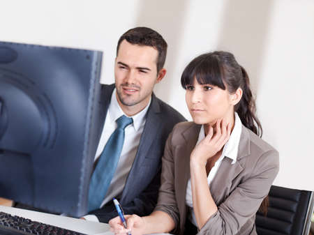 Two confident business people in the office at the meeting Stock Photo - 13019778