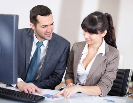 Two confident business people in the office at the meeting Stock Photo - 13020771