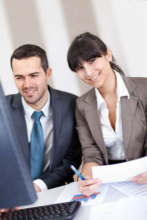 Two confident business people in the office at the meeting Stock Photo - 13019761