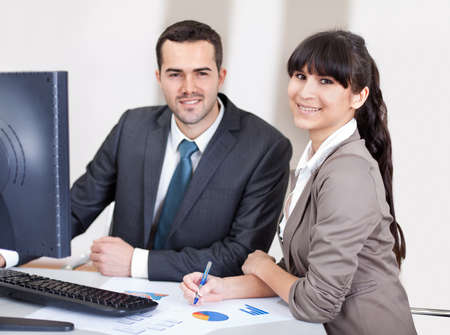 Two confident business people in the office at the meeting Stock Photo - 13019775