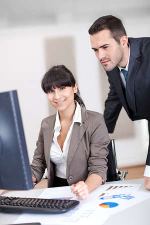 Manager overseeing business woman working on computer at the office Stock Photo - 13020766