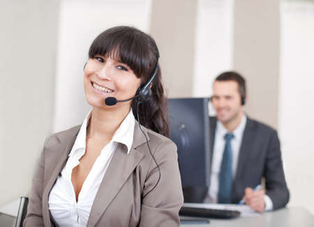 Team of young call center operators on the phone Stock Photo - 13020731