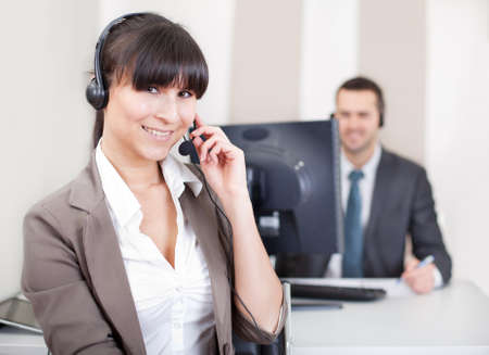 Team of young call center operators on the phone Stock Photo - 13019780