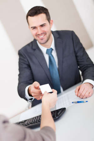 exchanging: Young businessman at the hiring interview in the office