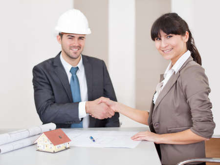 Two young architects at the office in the meeting Stock Photo - 13019783