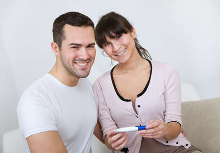 paternity: Young couple finding out results of pregnancy test at home