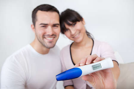 finding out: Young couple finding out results of pregnancy test at home