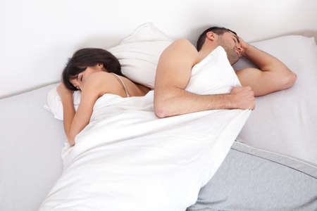 Lovely young couple sleeping on the bed Stock Photo - 13020705