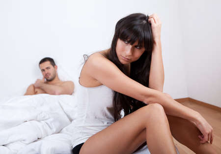 argument from love: Young couple in quarrel at home. Sitting in the bed Stock Photo
