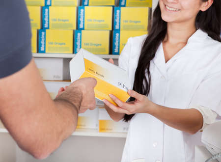 Men buying some medicine at the drugstore Stock Photo - 13020785