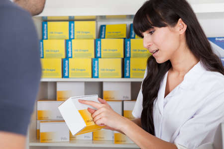 Men buying some medicine at the drugstore Stock Photo - 13019861