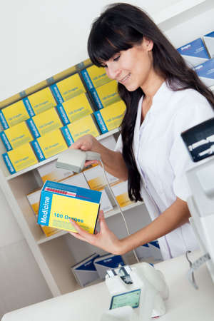 Pharmacist scanning barcode using scanner at drugstore Stock Photo - 13019865