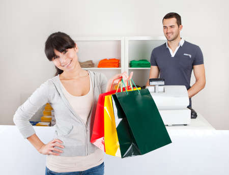 Female customer buying clothes at retail store Stock Photo - 13020602