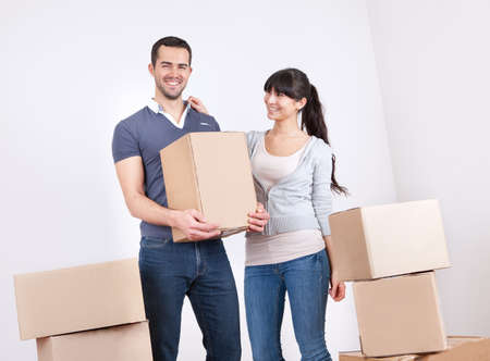 Happy young couple moving into new house photo