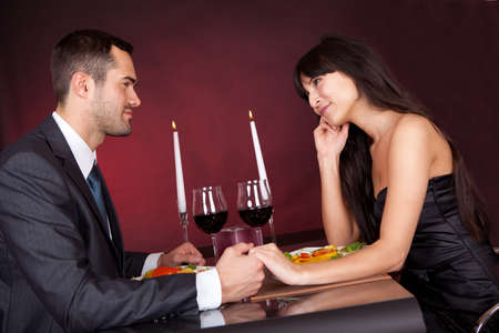 Lovely young couple having romantic dinner in restaurant photo