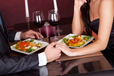 romantic couples: Lovely young couple having romantic dinner in restaurant